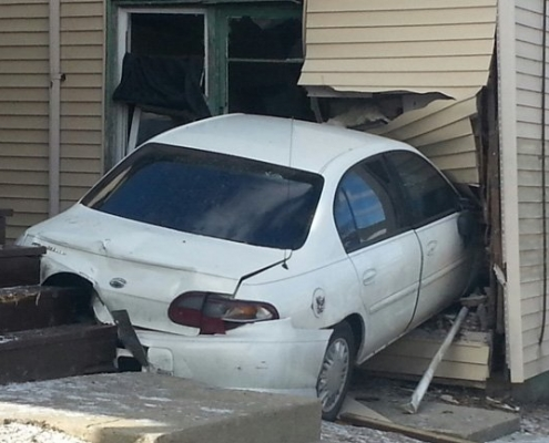 Car runs into house