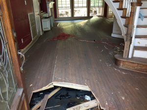 Buckled flooring after flooding in a home